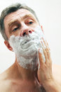 Image of man shaving mature Stock Image