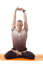 Image of middle-aged man posing in lotus posture Royalty Free Stock Image