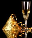 New years eve celebration with glass of champagne and party hat Royalty Free Stock Photo