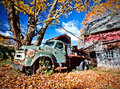 Image of an old abandoned truck and a barn