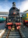 Image of old black steam locomotive at railroad station Royalty Free Stock Photo