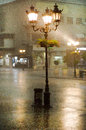 Image of old street lights in the rain
