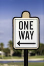An image of a one way road sign in south florida Royalty Free Stock Photos