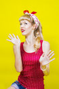 Image pin up girl on a yellow background Stock Images