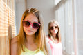 Image of 2 playful in sun glasses best girl friends or sisters beautiful blond young women having fun posing happy smiling Royalty Free Stock Photo