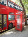 A red bus and typical phone box of London Royalty Free Stock Photo