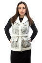 Image of serious brunette in fake fur waistcoat the on white background Royalty Free Stock Photos