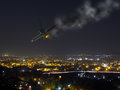 Image showing crashing passenger plane mid air complete smoke trail fire engine night time perfect image illustrating aviation Stock Image