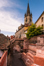 Image showing the evangelical church its famous tower and some of the old town s fortification walls Stock Photography