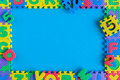 Image of simple poster frame of child toy puzzle. Mockup and template scene with blue background Royalty Free Stock Photo