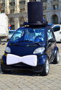 Image small black car dressed as groom bow hat marriage fest Stock Images