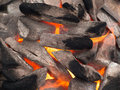 Image of stones with soot tongues of fire on the background Royalty Free Stock Images