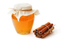 Image sweet honey jar cinnamon white background Royalty Free Stock Photos