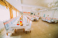 Image of tables setting  in orange colour at a luxury wedding hall Royalty Free Stock Photo