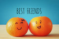 Image of two clementines with drawn smiley faces Royalty Free Stock Photo