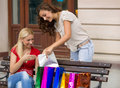 Image of a two young women with shopping bags modern outdoors Stock Photo