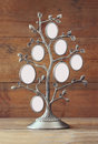 Image of vintage antique classical frame of family tree on wooden table Royalty Free Stock Photo