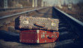 The image of vintage suitcases forgotten on railway tracks two old Royalty Free Stock Image