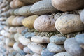 Image wall exactly paved with colourful stones of the summer Stock Photography