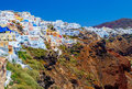 Image of white city on a slope of hill sunset, Oia, Santorini, Greece Royalty Free Stock Photo