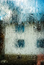 Image of white house through wet glass Royalty Free Stock Photo