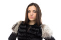Image of woman in black fur waistcoat on white background Stock Images