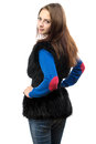 Image of woman in fake fur waistcoat from the back young on white background Stock Photography
