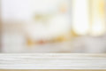 image of wooden table in front of abstract blurred window light background Royalty Free Stock Photo