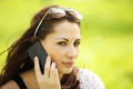 Image of young beautiful girl in city park speaks by mobile phone woman Royalty Free Stock Photos