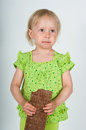 The image of young girl eating bar of chocolate Stock Photos