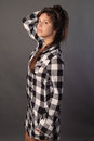 An image of a young woman in a checkered shirt dress Stock Photography