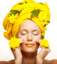 Image of a young woman with yellow chrysanthemums Stock Images