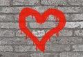 A imagem da pintura do coração em uma parede de tijolo Fotografia de Stock Royalty Free