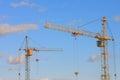 Imagem dos guindastes de torre com céu azul foto conservada em estoque Imagens de Stock Royalty Free