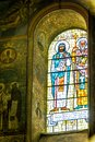 Images of Orthodox saints on the stained glass window of the church Royalty Free Stock Photo