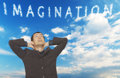 Imagination handsome young businessman looking up in the sky where clouds spell the word Royalty Free Stock Photo