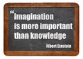 Imagination and knowledge is more important than a quote from albert einstein white chalk text on a vintage slate blackboard Royalty Free Stock Photo