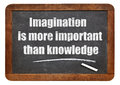 Imagination and knowledge quote is more important than a from albert einstein white chalk text on a vintage slate blackboard Stock Photos