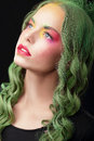 Imagination woman with dyed hair and fancy creative makeup make up Stock Images
