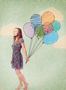 Imagination young woman is standing with drawn balloons Stock Photo