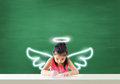 Imagine of little angel drawing her dream happiness Royalty Free Stock Photo