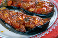 Imam bayildi dishes found in turkish cuisine whole braised eggplant stuffed with onion garlic and tomatoes Royalty Free Stock Photo