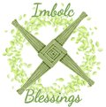 Imbolc Blessings. Beginning of spring pagan holiday. Brigids Cross in a wreath of green leaves