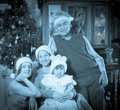 Imitation of antique photo of happy family posing for christmas portrait Royalty Free Stock Images