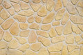 Imitation stone wall closeup in sunny day Royalty Free Stock Photography