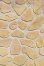 Imitation stone wall closeup in sunny day Royalty Free Stock Images