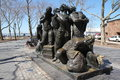 Immigrants sculpture here near staten island ferry a which illustrate migration at the beginning of th century Royalty Free Stock Image