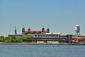 Immigration museum on Ellis Island with Statue of Liberty Behind Royalty Free Stock Photo