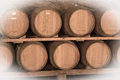 Immitation of aged image of old winemakers cellar with many barrels Stock Photo