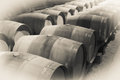 Immitation of vintage photo of old winemakers cellar with many barrels Royalty Free Stock Images